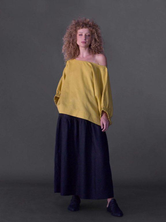 AMMA_Frühjahr_Sommer 2022 Skirt black and yellow shirt